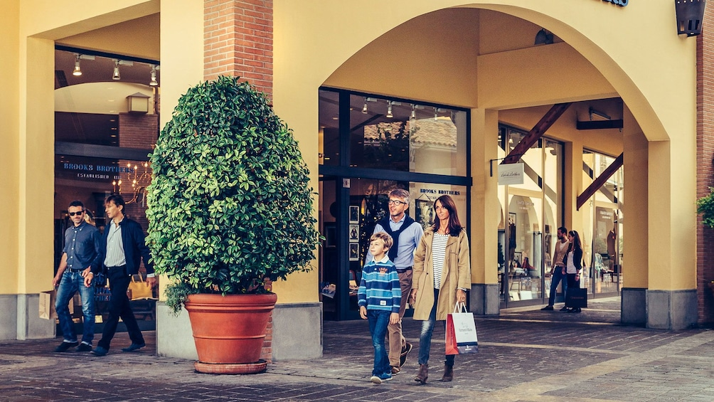 Show item 3 of 6. Humans shopping in a Italian shopping complex