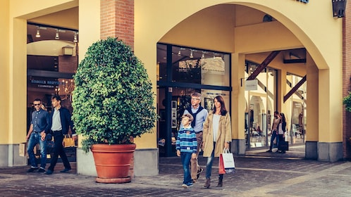 Humans shopping in a Italian shopping complex