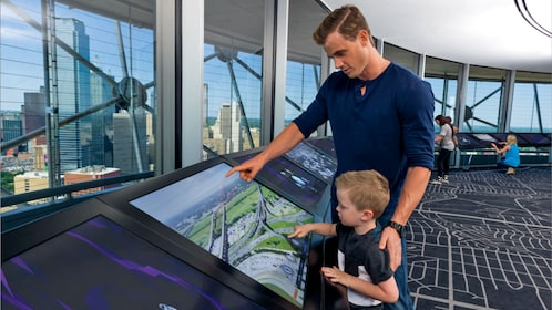 father and son in the observation deck in Dallas