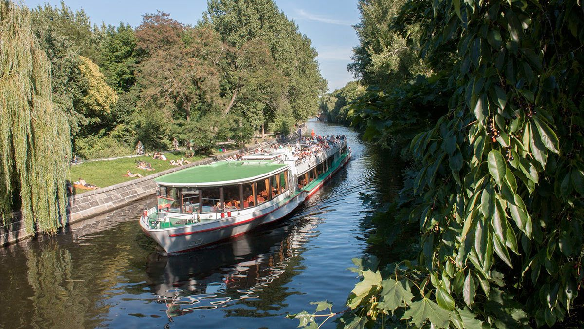 View of the Berlin Cruise with Pizza and Drink cruising down a river