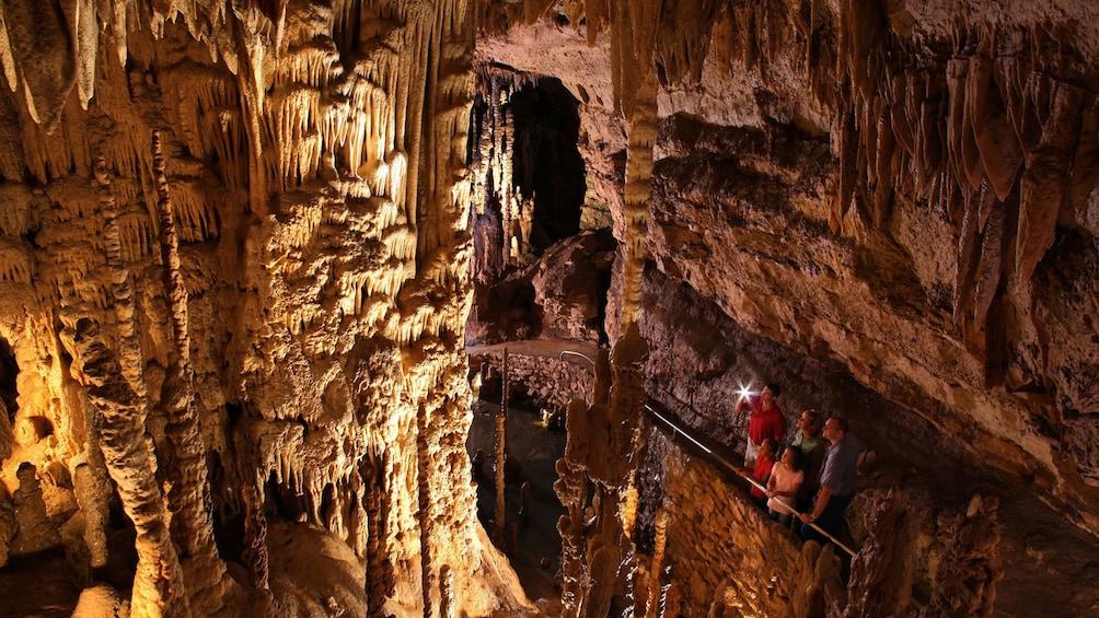 People exploring a cave in San Antonio