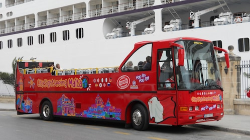 Hop on Hop Off bus tour of Malta next to cruise ship