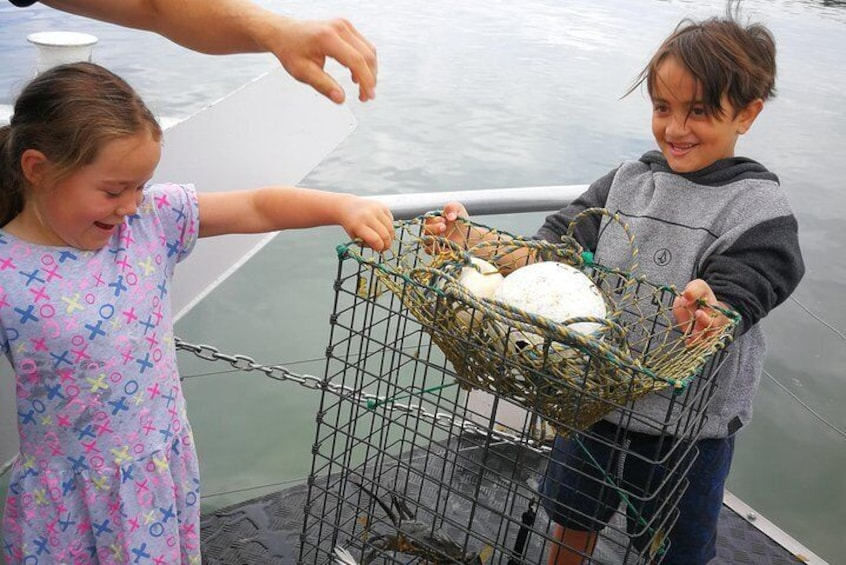 It takes more then two little hands to pull up these crab pots!