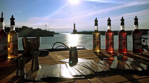 Table at a restaurant with a view of the coast at sunset in Chania