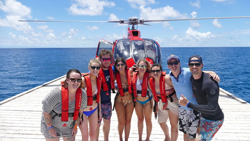 Show item 5 of 8. group on a helicopter water landing pad in Australia