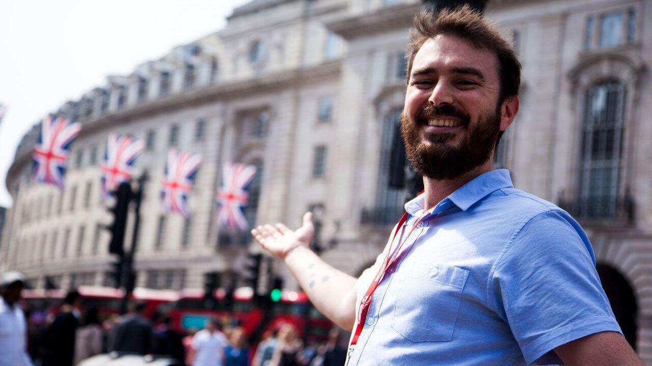 Smiling man gesturing in London