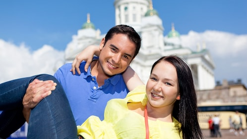 Man holding a woman posing for a photo in Helsinki