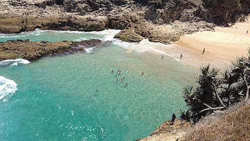 Swimmers at a secluded beach on North Stradbroke Island