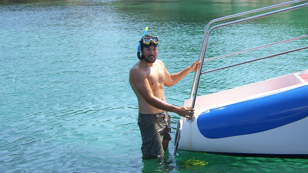 Man climbs back into a boat.