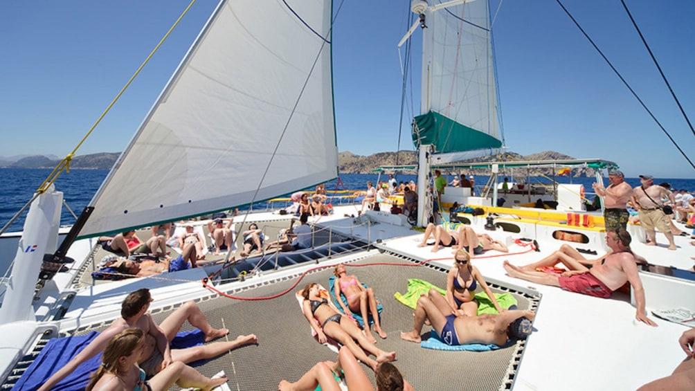 Sunbathers on a Catamaran