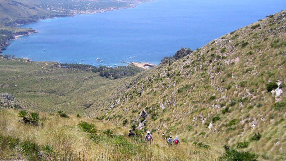 Hikers on a path near the coast of Mallorca Island
