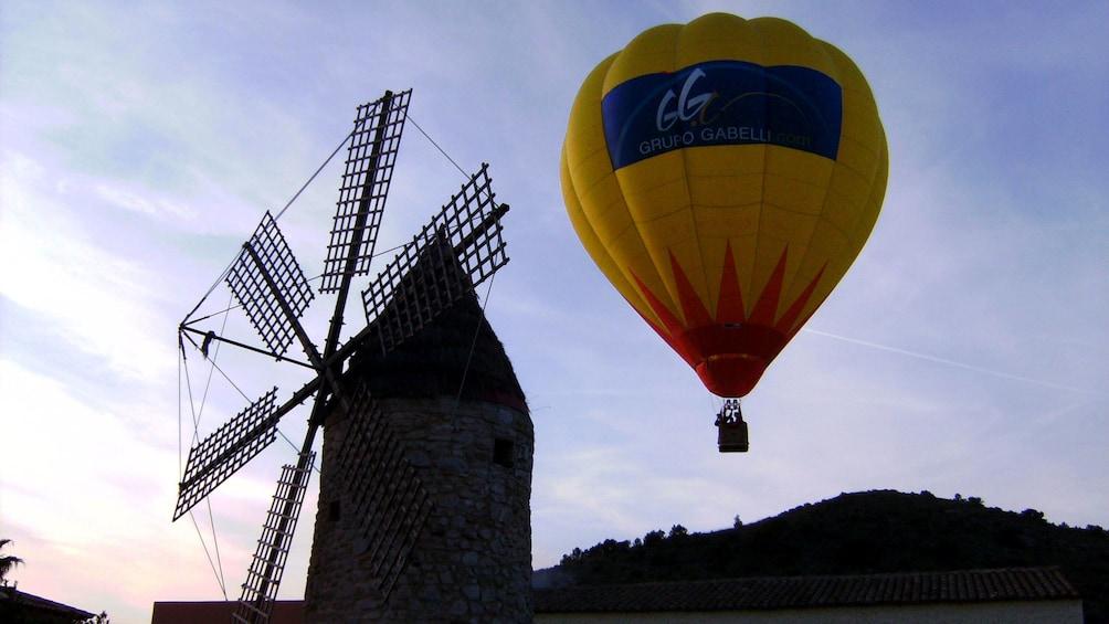 Hot air balloon near windmill on Mallorca Island