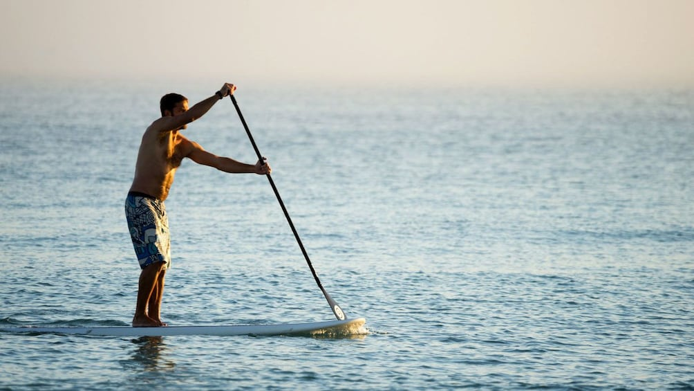 Show item 1 of 5. Man on a stand-up paddling board on Mallorca Island