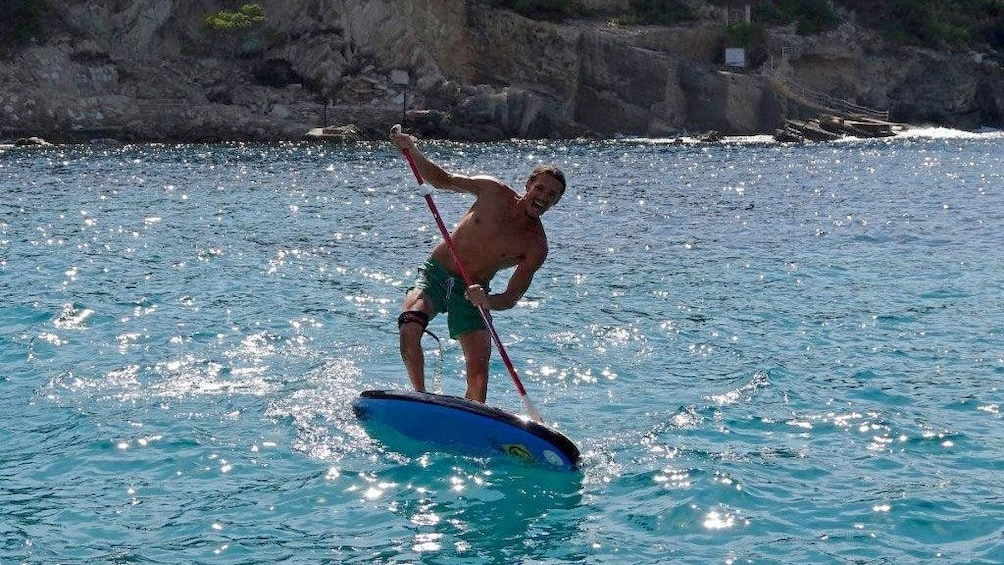 Show item 2 of 5. Man on stand-up paddling board on Mallorca Island