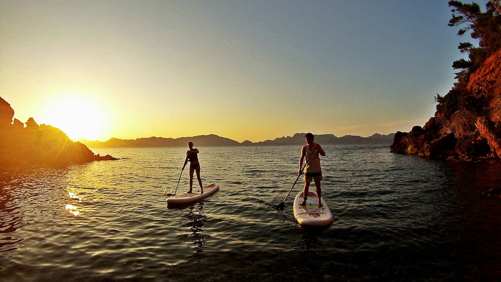 Show item 5 of 5. Pair on stand-up paddling boards on Mallorca Island