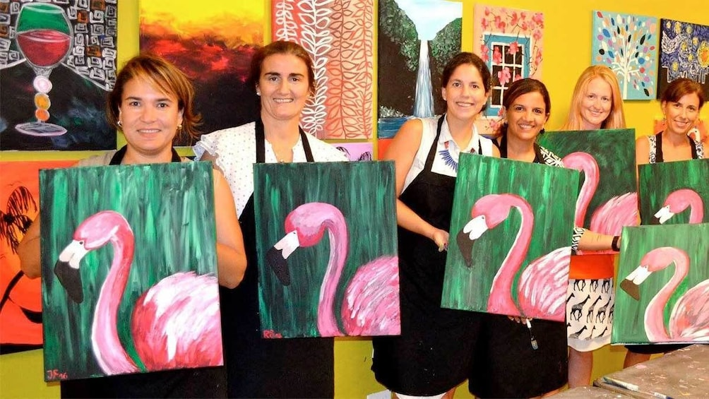 Show item 3 of 5. Group with flamingo paintings from the Paint and Sip Party in Nassau