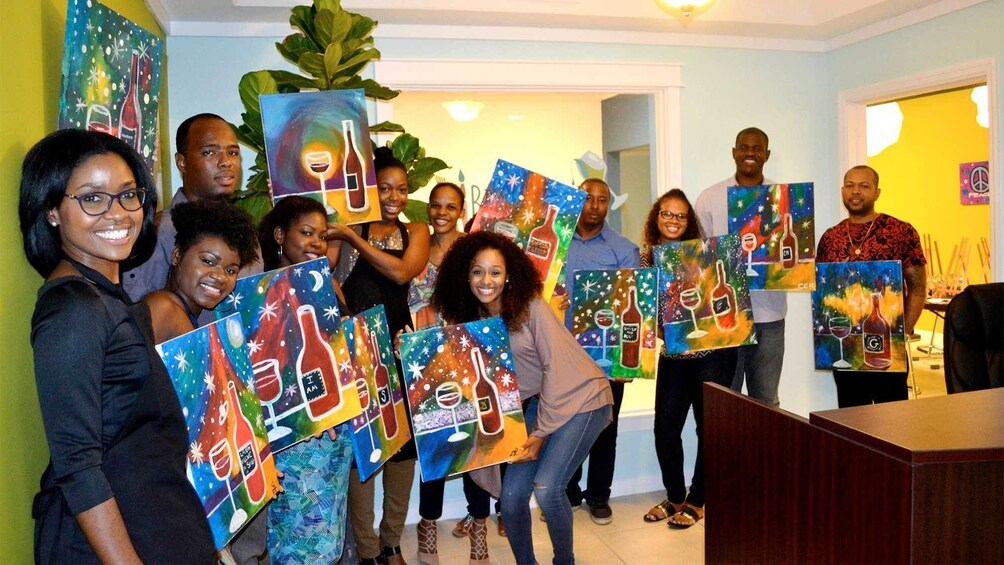 Show item 4 of 5. Large group at the Paint and Sip Party in Nassau