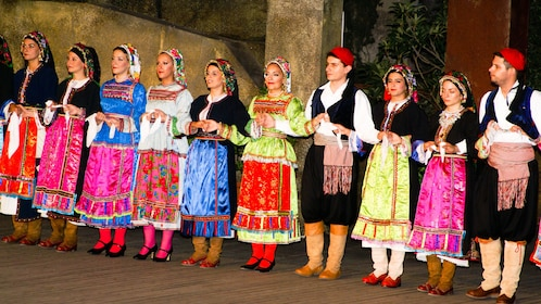 Row of dancers in colorful costumes in Athens