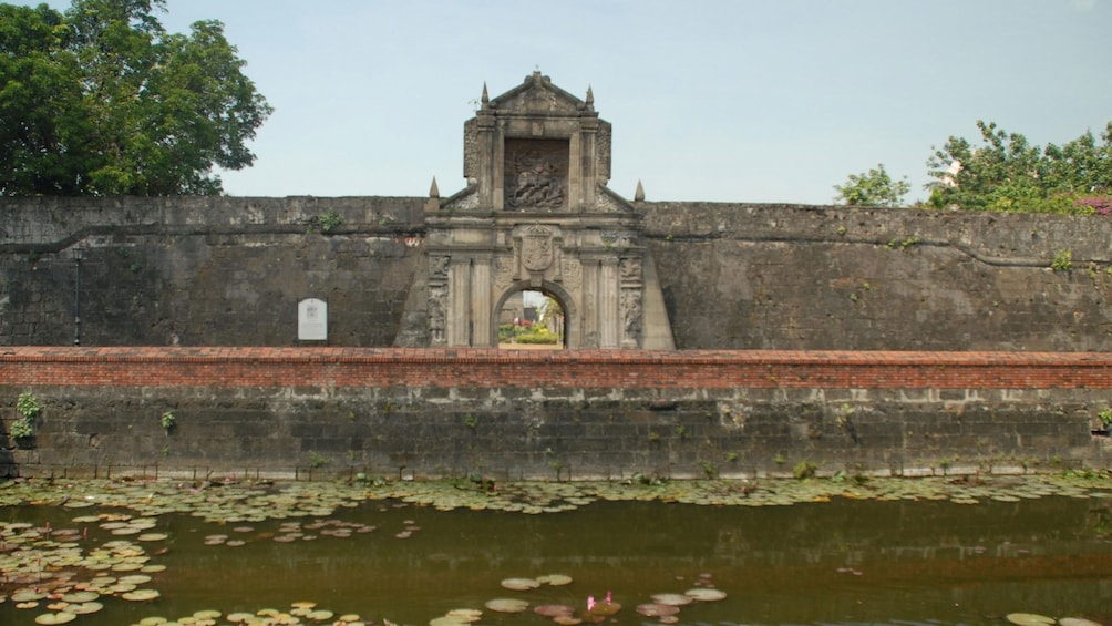 Show item 3 of 5. Stone building next to river in Manila