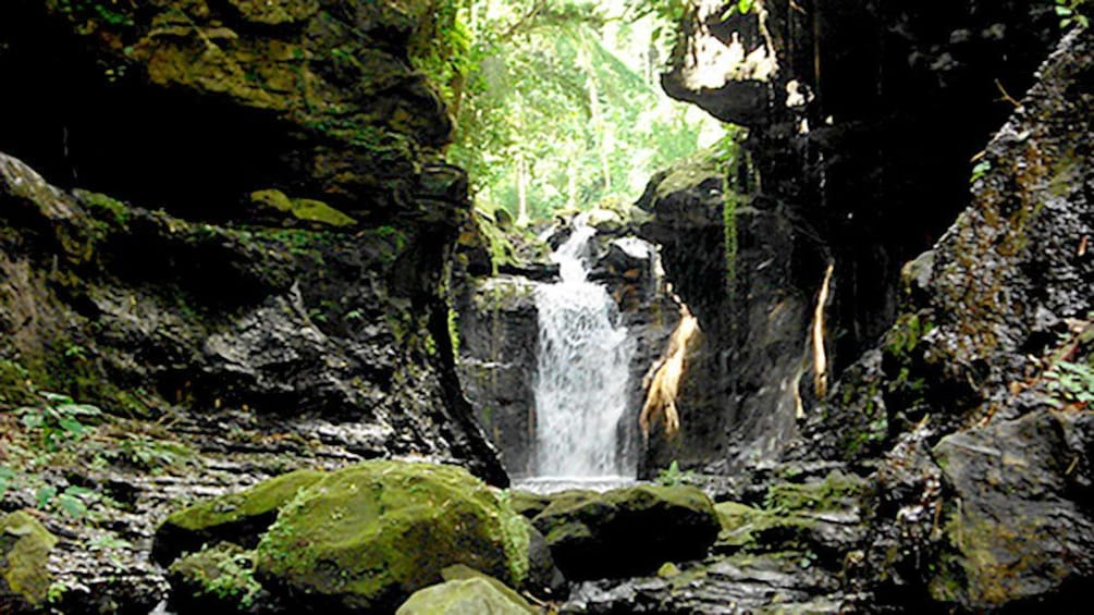Show item 4 of 4. Waterfall and lagoon in the Philippines