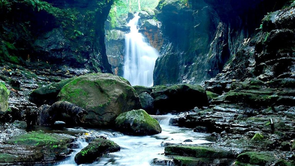 Show item 1 of 4. Waterfall and lagoon in Philippines