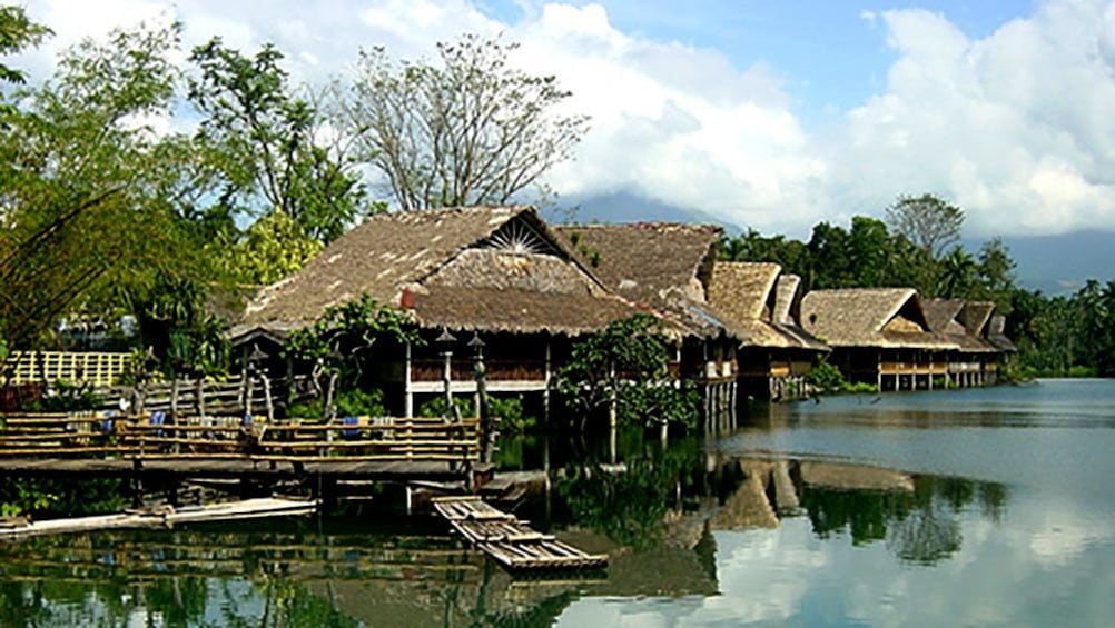 Show item 1 of 6. Thatch huts on a lake in Philippines