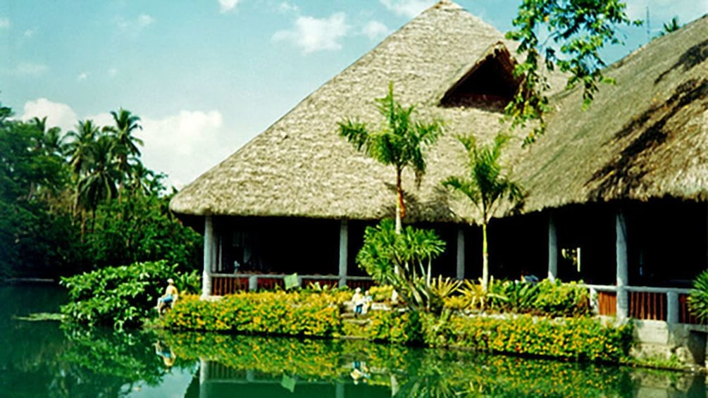 Show item 2 of 6. Large huts on Philippine lake