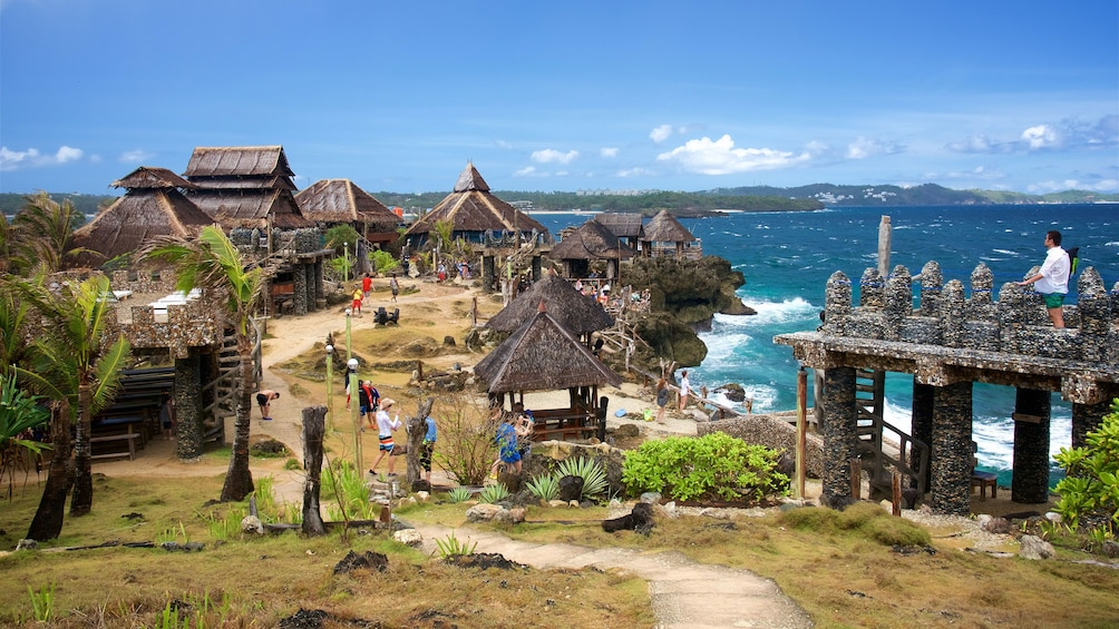 Show item 4 of 6. Huts next to coast in Philippines