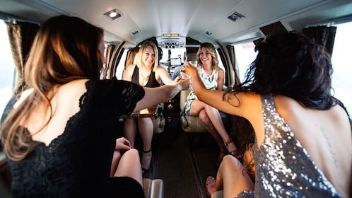 Four women on a Jet toasting champagne