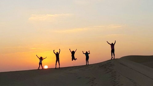Silhouette of tour group in the desert in Abu Dhabi