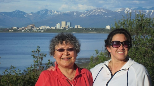 Pair of women with city in the background in Anchorage
