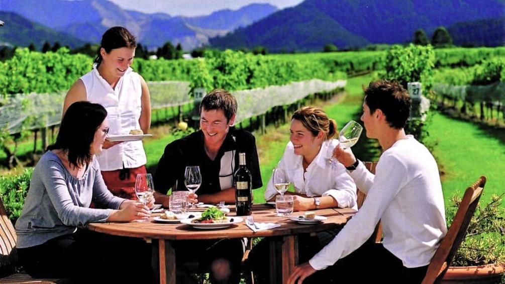friends enjoying meal outside