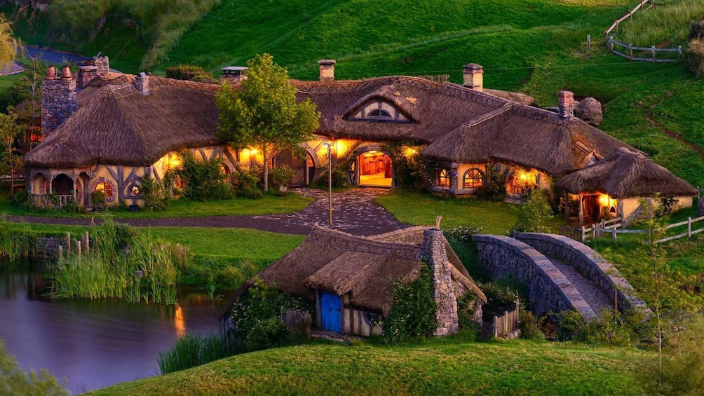 Show item 3 of 5. Hobbiton houses and pond at night
