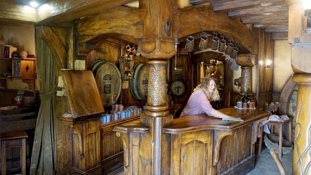 Show item 2 of 5. Inside the Green Dragon Inn pub at Hobbiton