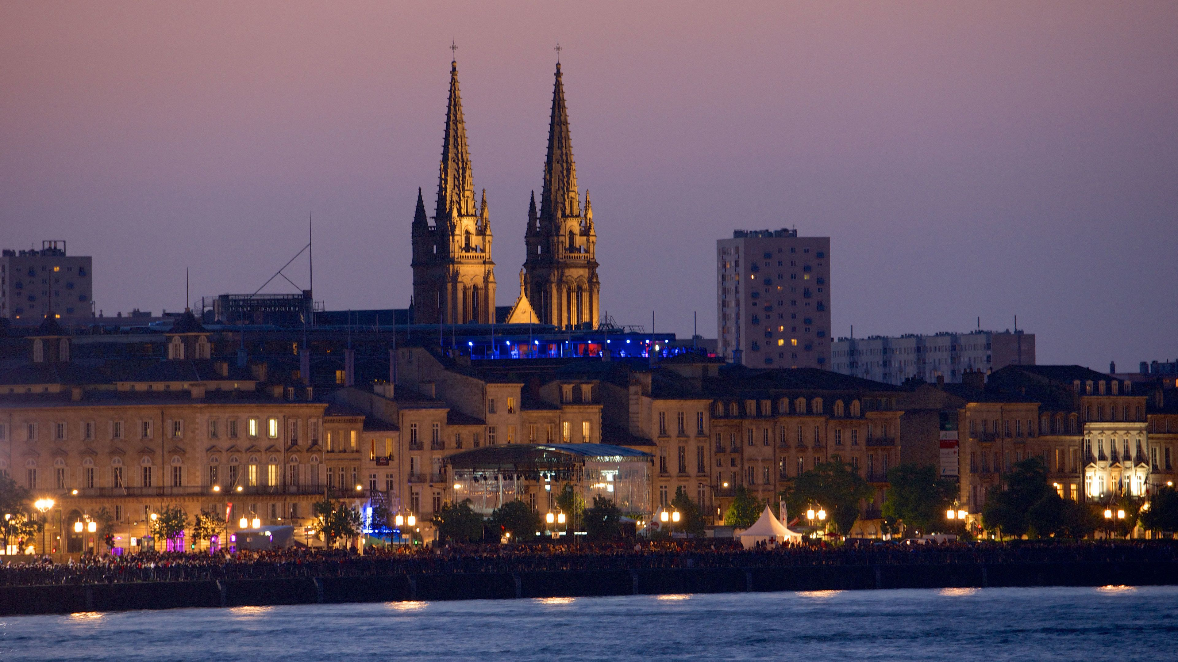 City on the rivers edge at night in Bordeaux