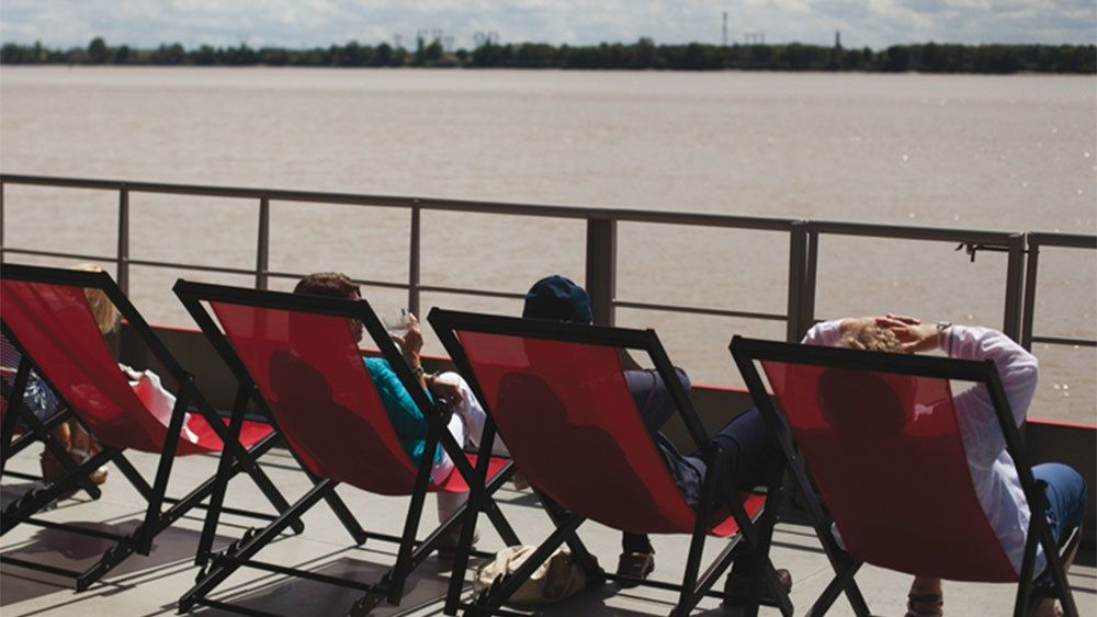 Boating passengers in lounge chairs in Bordeaux