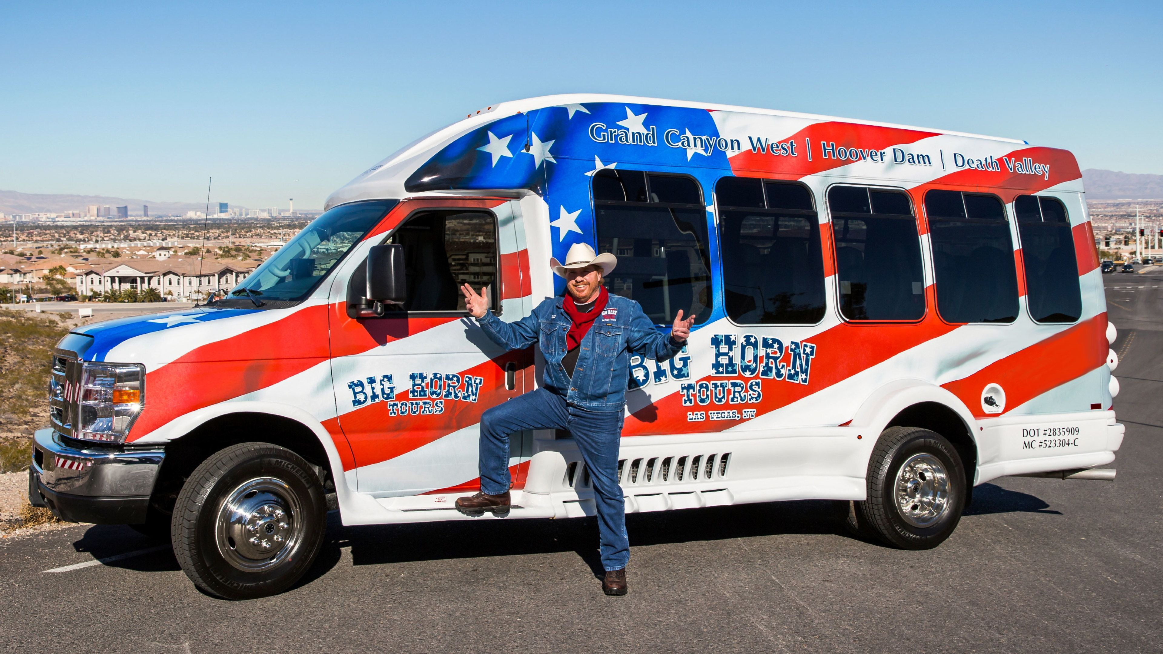Tour guide in front of American Flag-inspired Van at the Grand Canyon