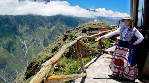 Local woman standing on a path in an Andes mountain town