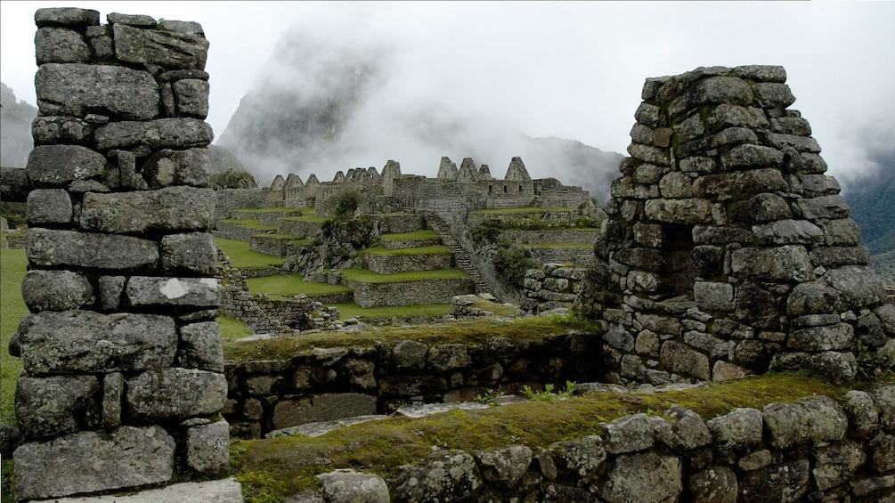 Show item 5 of 5. Machu Picchu ruins in the mist