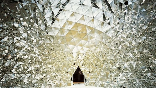 Inside the Crystal dome full of reflective surfaces in Swarovski Kristallwelten in Innsbruck.
