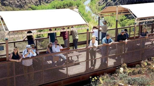 People on the first class open-air section of a train in Sedona