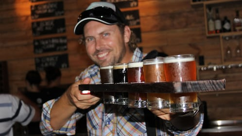Man with flight of beer at a bar in Sydney