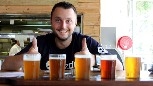 Bartender with flight of beer at a bar in Sydney