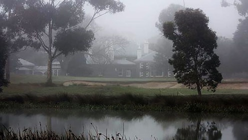 haunted house in fog near river bank at Ghost Tour in Melbourne