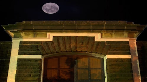 full moon above brick building and windows in Melbourne