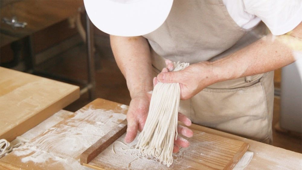 Person making soba in Tokyo