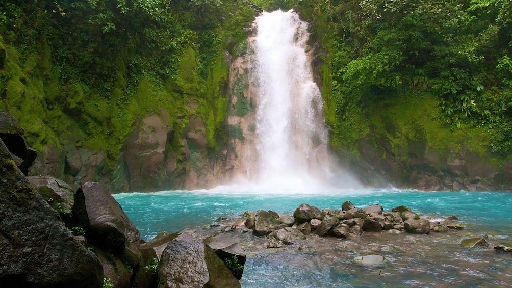 Show item 4 of 4. Blue river falls in Costa Rica