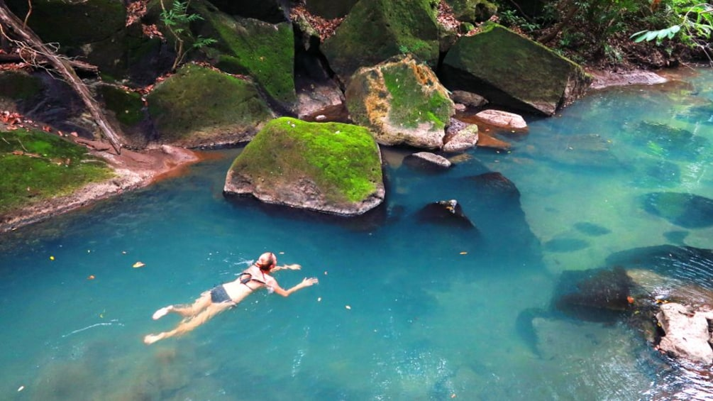 Show item 1 of 4. Woman swims in a river in Costa Rica
