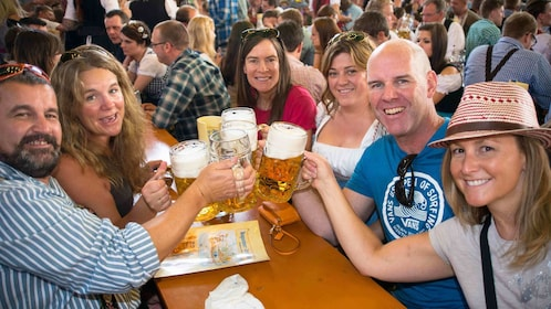 Group toasting with beer in Munich