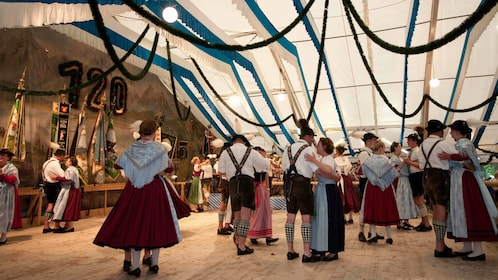 People dancing in traditional German clothing in Munich
